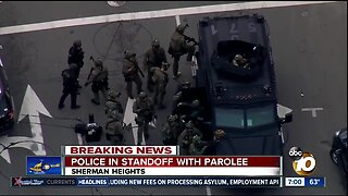 Police in standoff with parolee