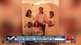 Woman reunites with biological family
