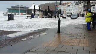 Storm Brian floods British streets