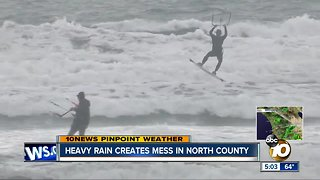 Kite surfers take advantage of windy conditions