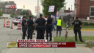 Police confront protesters at ICE office in Detroit