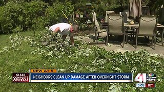 Neighbors clean up damage after overnight storm