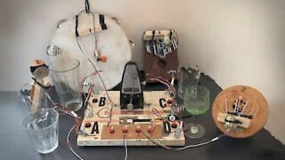 Guy makes music using metronome and glasses of water