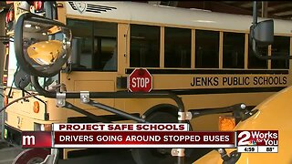 Drivers going around stopped school buses