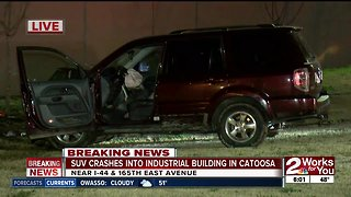 SUV crashes into industrial building in Catoosa
