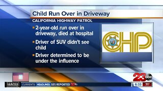 Child run over in driveway, driver determined to be under the influence