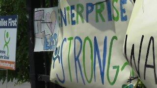 Students hang posters pleaded to keep Enterprise Charter School open