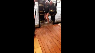 Firefighters carry woman to safety during extreme flooding