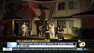 Firefighters rescue man inside of burning home