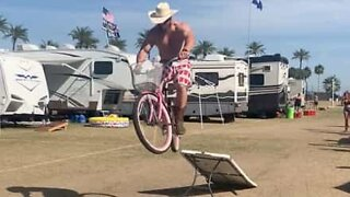 Festivalgoer jumps and breaks bicycle