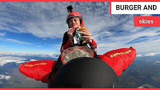 Amazing footage shows skydiver tucking into a burger