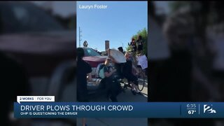 Driver plows through crowd of protesters on I-244