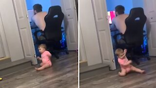 High-energy baby hysterically dances to the music