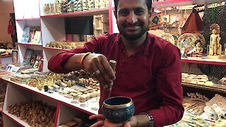 Mysterious singing bowl demonstrated by shop owner in India
