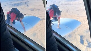 DAREDEVIL CLIMBS OUT ON TO PLANE WING AND HANGS ON BEFORE BACKFLIPPING INTO THE AIR
