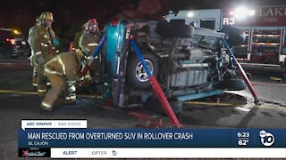 Man rescued from overturned SUV rollover crash