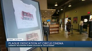 Librarian recognized at The Outsider's plaque dedication at Circle Cinema