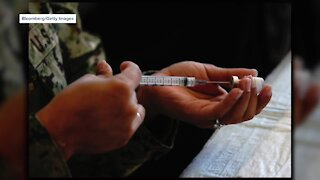 Men and women experiencing different side effects of COVID vaccine