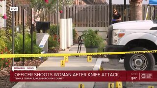 Officer shoots, kills woman after knife attack