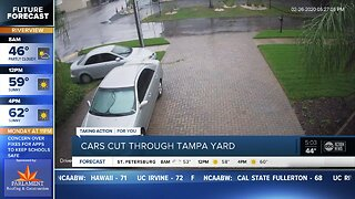 Cars cut through Tampa yard