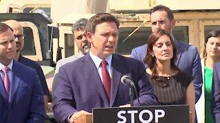 Florida Gov. Ron DeSantis speaks at National Guard armory in Miami