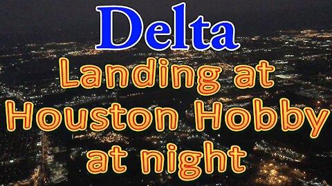 Delta flight landing at Houston Hobby at night