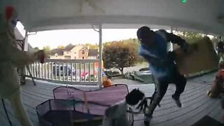 Delivery man scared by Halloween decor