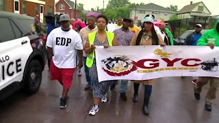 Community and police rally against gun violence together after violent weekend