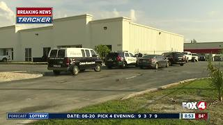Crime scene investigation in front of Fort Myers business