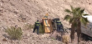 Tree-trimming truck rolls down cliff in Henderson