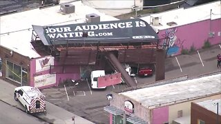 Strong winds topple billboard on South Broadway