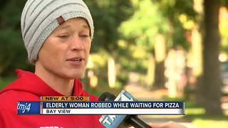 Elderly woman robbed while waiting for pizza delivery