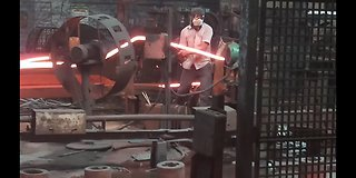Man Working with red hot iron