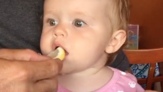 Baby makes hysterical face after tasting lemon