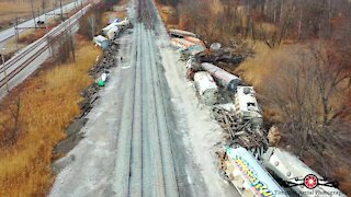Drone footage captures mangled aftermath of train derailment in Indiana