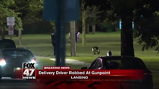 Pizza delivery driver robbed at gunpoint in Lansing