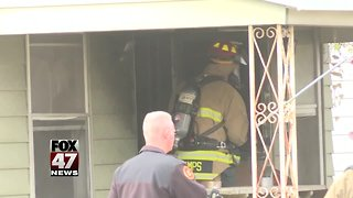 3 displaced after house fire in Lansing