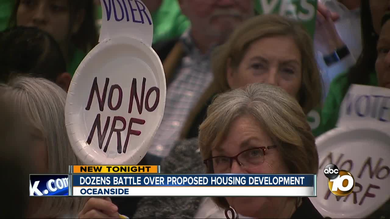 Dozens battle over proposed housing development