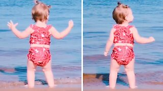 Inspirational baby girl can't stop dancing at the beach