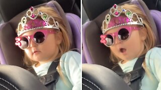 Baby caught singing song in the back seat