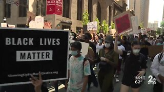 Protests continue throughout downtown Baltimore Monday night