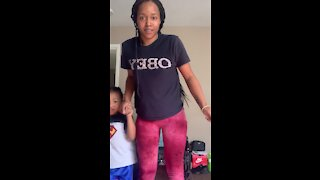 4-year-old son helps mom take her first steps
