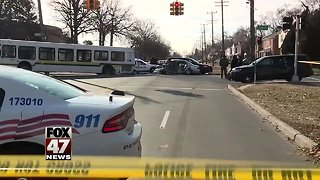 2 people die after their car crashes into Detroit bus