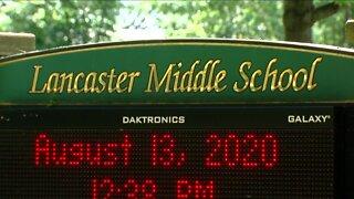Lancaster parents must decide: home vs school?