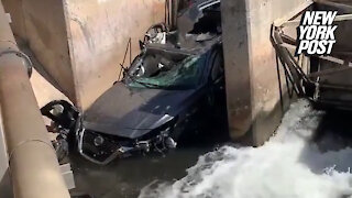 Car somehow crashes into water canal