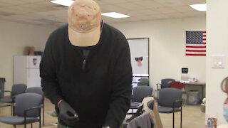 Arizona National Guard members train retired medical professionals on Moderna vaccine immunization.