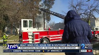 Firefighters battle more than flames during Baltimore house fire