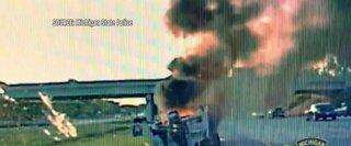 Trooper saves man from burning car