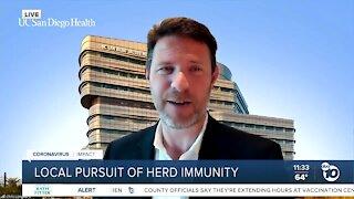 Local pursuit of herd immunity