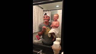 Little girl shows how tough she is with adorably funny flex in the mirror